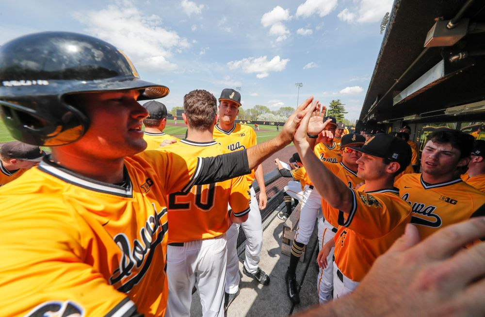 Iowa Hawkeyes infielder Kyle Crowl (23) high fives teammates after scoring against the Oklahoma State Cowboys Sunday, May 6, 2018 at Duane Banks Field. (Brian Ray/hawkeyesports.com)