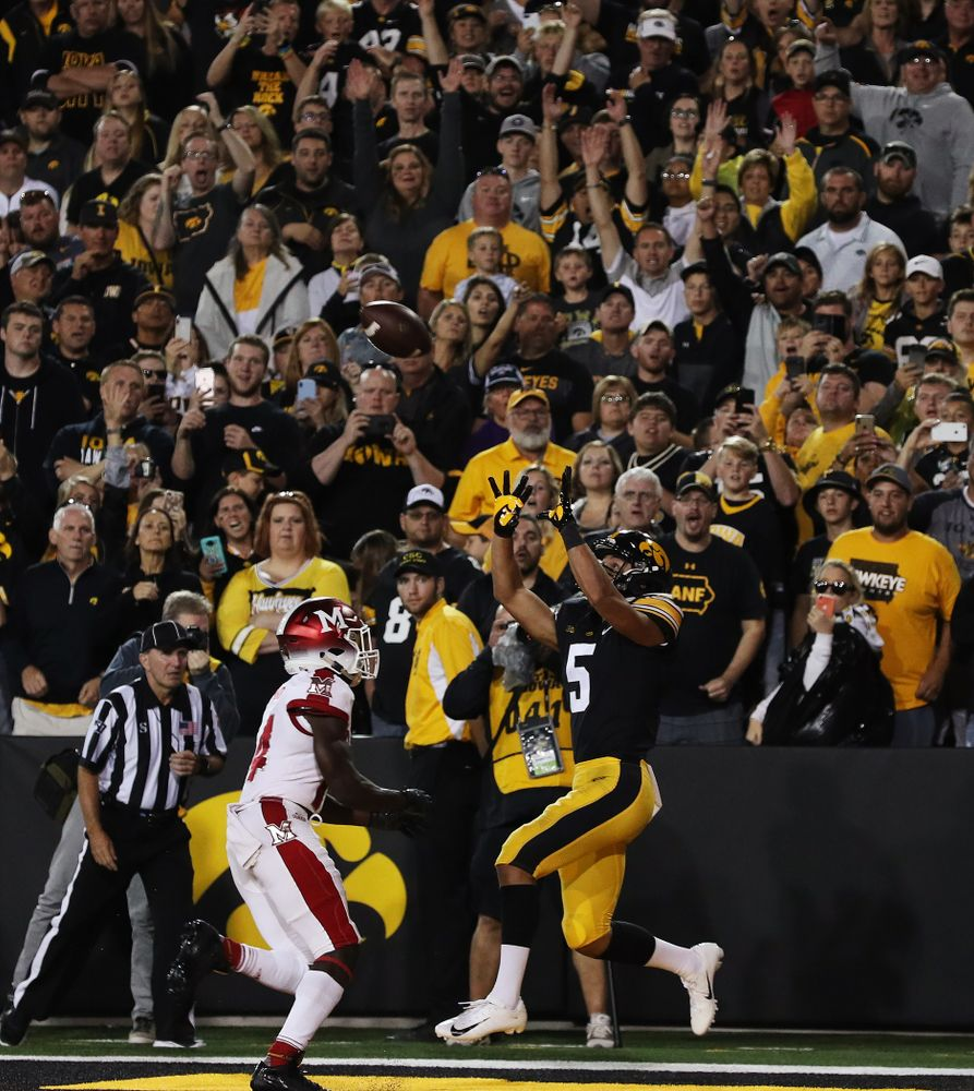 Iowa Hawkeyes wide receiver Oliver Martin (5) hauls in a touchdown pass against the Miami RedHawks Saturday, August 31, 2019 at Kinnick Stadium in Iowa City. (Brian Ray/hawkeyesports.com)