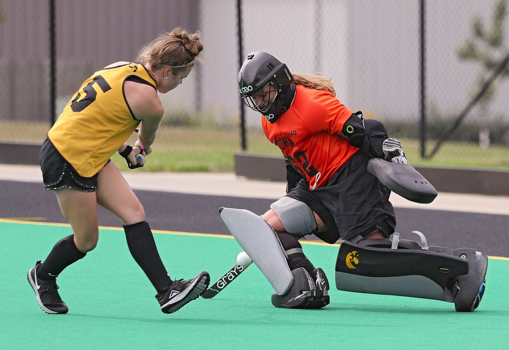 Iowa's Grace McGuire (62) blocks a shot by Meghan Conroy (5) during practice at Grant Field in Iowa City on Thursday, Aug 15, 2019. (Stephen Mally/hawkeyesports.com)