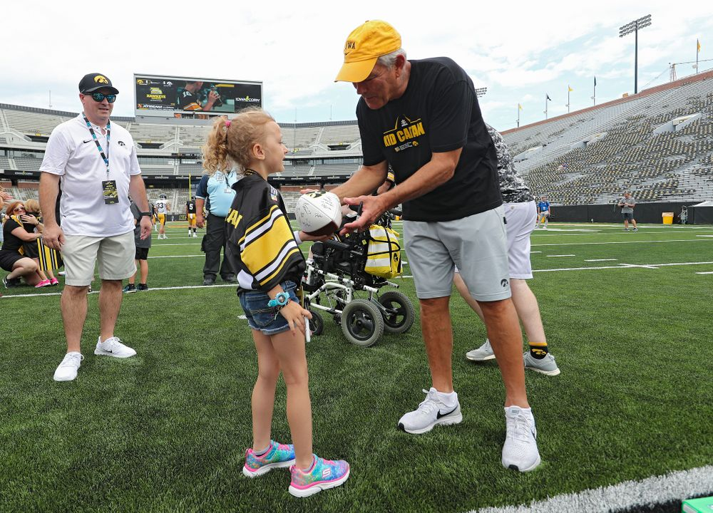Kid Captain Charlotte Keller talks with Iowa Hawkeyes head coach Kirk Ferentz during Kids Day at Kinnick Stadium in Iowa City on Saturday, Aug 10, 2019. (Stephen Mally/hawkeyesports.com)