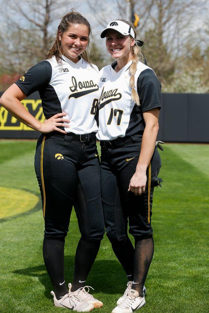 Iowa Hawkeyes pitcher Lauren Shaw (8), Iowa Hawkeyes outfielder Allie Wood (17)