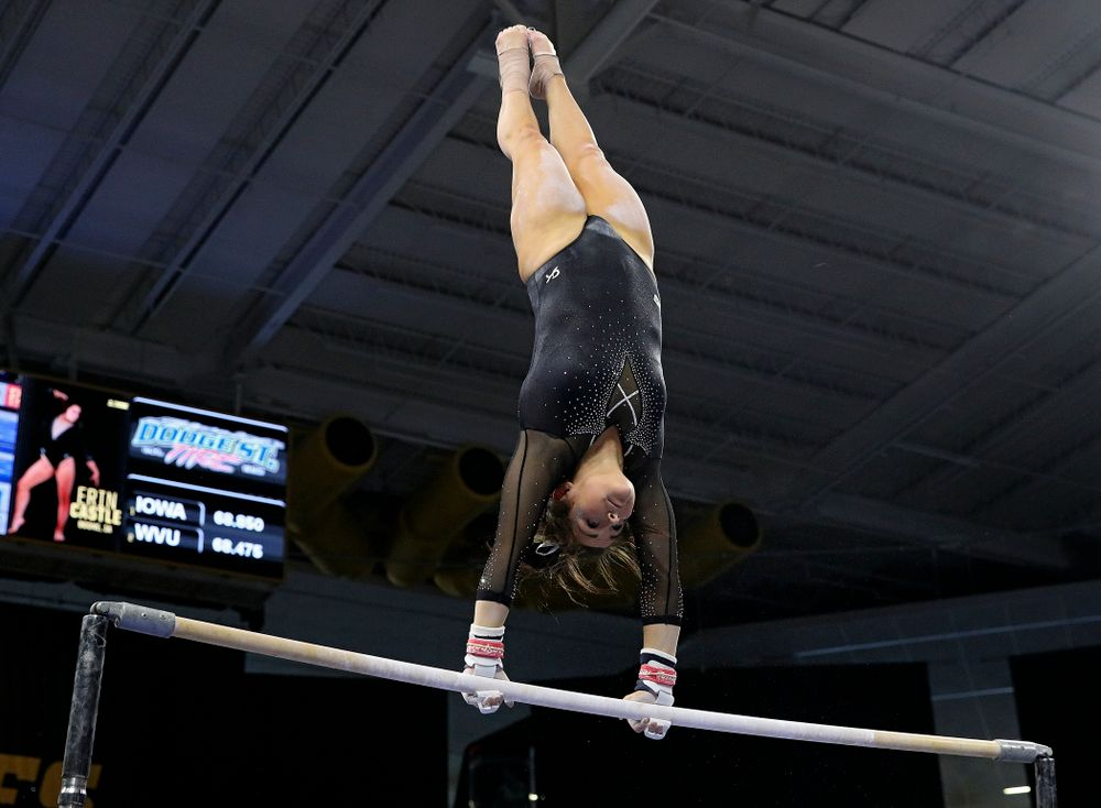 Iowa's Erin Castle competes on the bars during their meet at Carver-Hawkeye Arena in Iowa City on Sunday, March 8, 2020. (Stephen Mally/hawkeyesports.com)