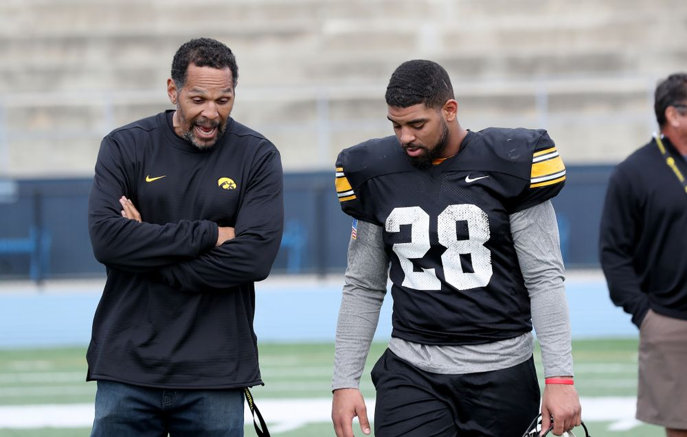 Former Hawkeye Football player Quinn Early talks with running back Toren Young (28) following Holiday Bowl Practice No. 3  Tuesday, December 24, 2019 at San Diego Mesa College. (Brian Ray/hawkeyesports.com)