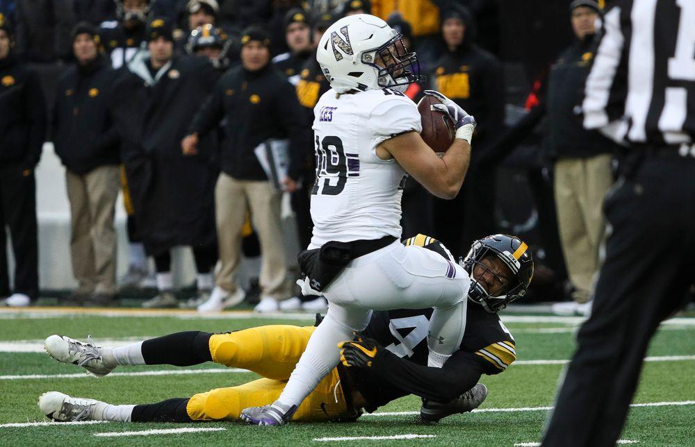 Iowa Hawkeyes defensive back Josh Turner (4) makes a tackle during a game against Northwestern at Kinnick Stadium on November 10, 2018. (Tork Mason/hawkeyesports.com)