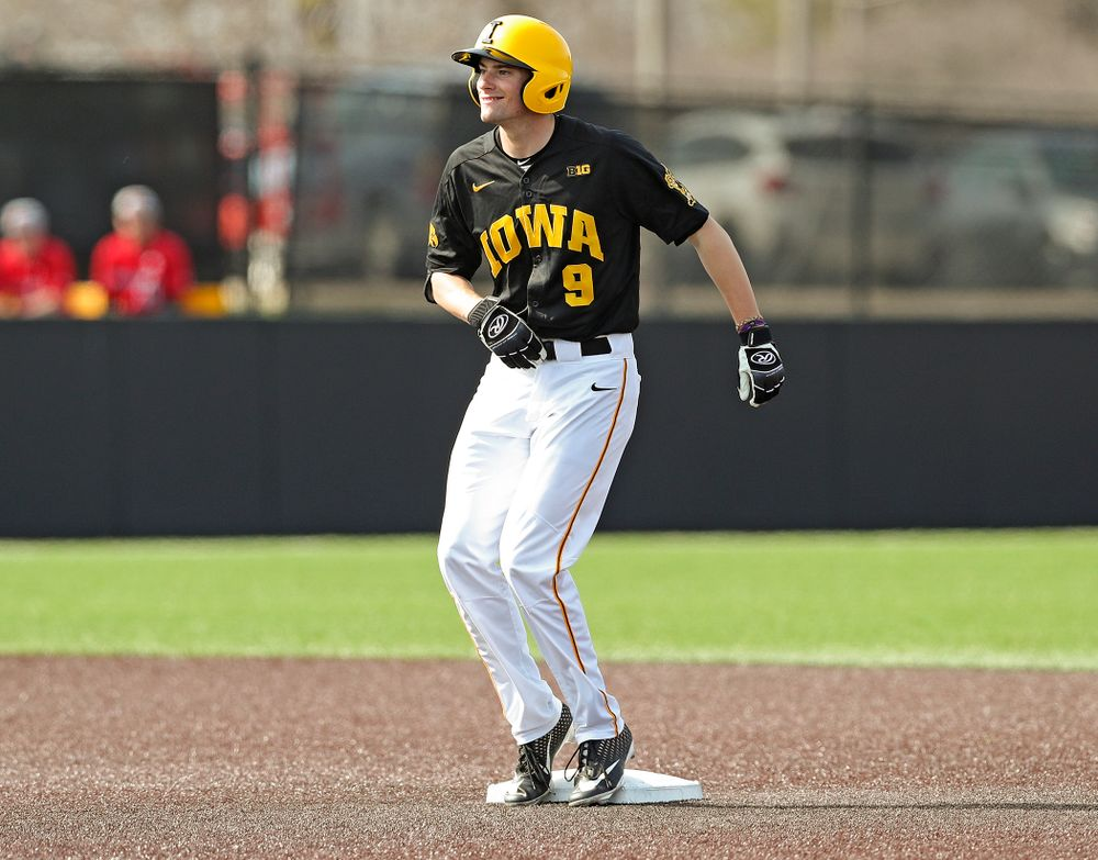 Iowa Hawkeyes center fielder Ben Norman (9) dances on second base after hitting an RBI double during the sixth inning of their game against Rutgers at Duane Banks Field in Iowa City on Saturday, Apr. 6, 2019. (Stephen Mally/hawkeyesports.com)
