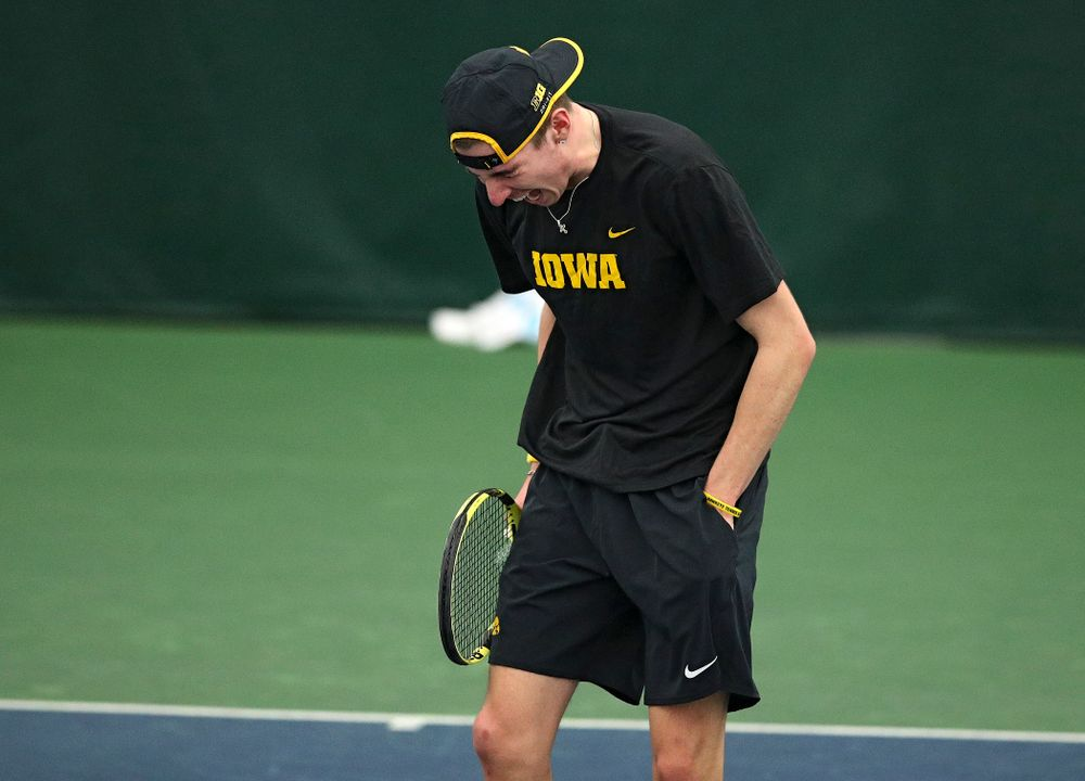 Iowa's Nikita Snezhko celebrates a point during his doubles match at the Hawkeye Tennis and Recreation Complex in Iowa City on Friday, March 6, 2020. (Stephen Mally/hawkeyesports.com)