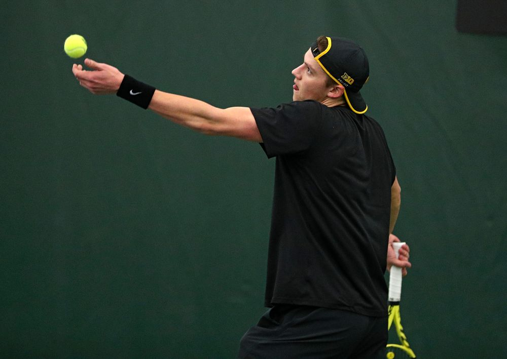 Iowa's Joe Tyler serves during his singles match at the Hawkeye Tennis and Recreation Complex in Iowa City on Friday, March 6, 2020. (Stephen Mally/hawkeyesports.com)
