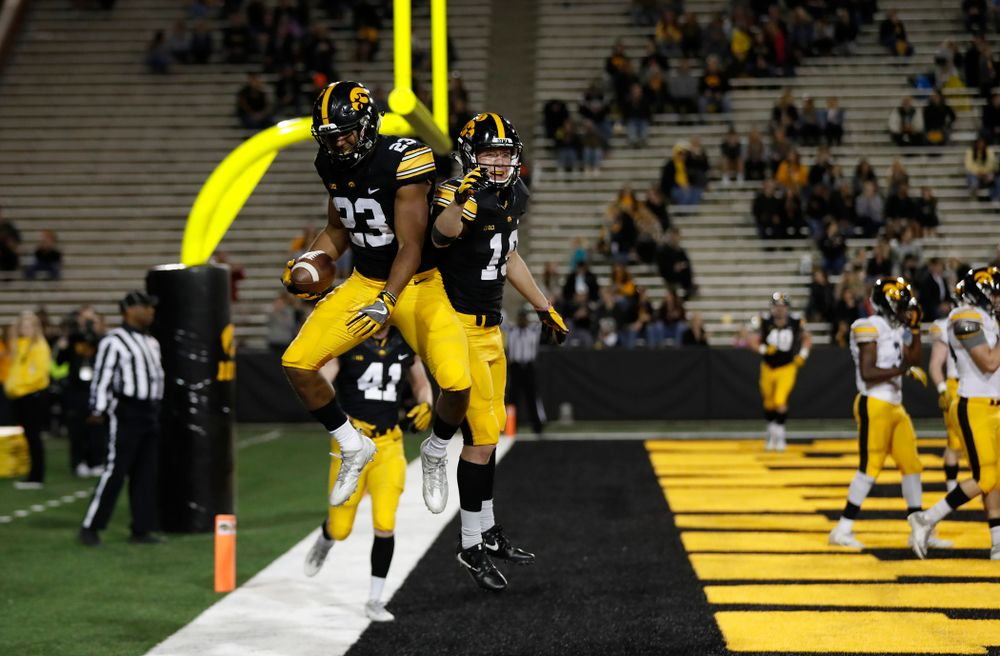 Iowa Hawkeyes wide receiver Dominique Dafney (23) and wide receiver Max Cooper (19) during the final spring practice Friday, April 20, 2018 at Kinnick Stadium. (Brian Ray/hawkeyesports.com)