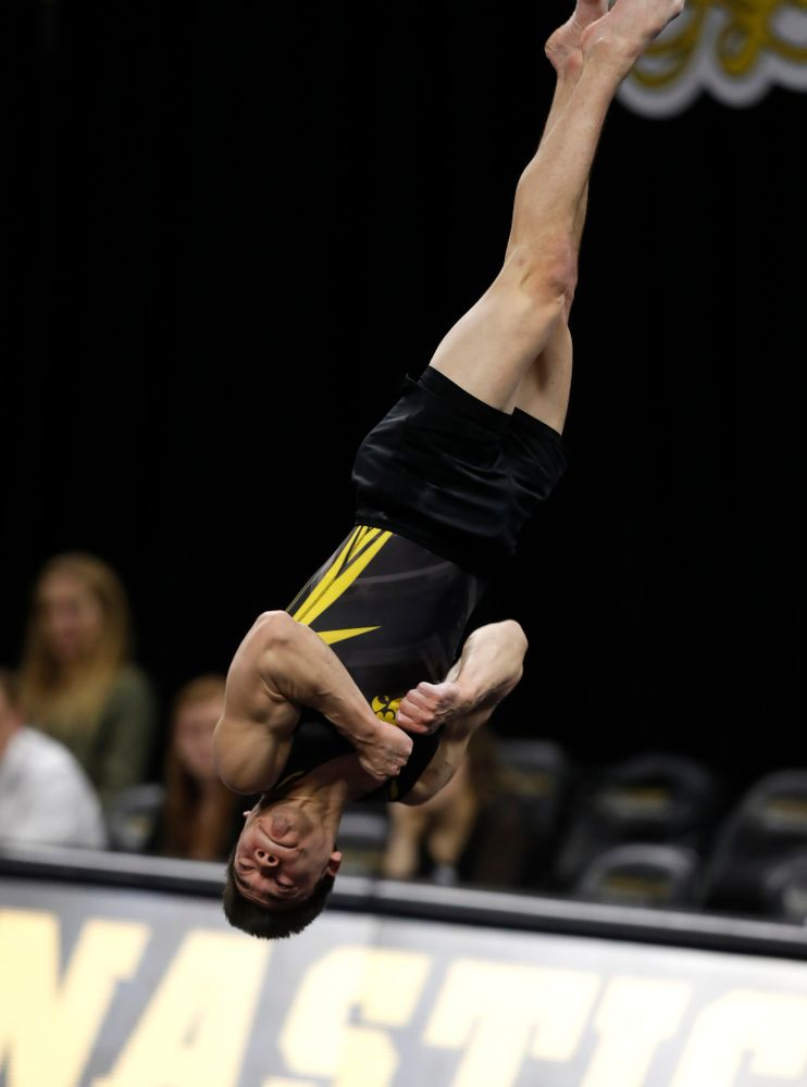 Iowa's Brandon Wong competes on the floor