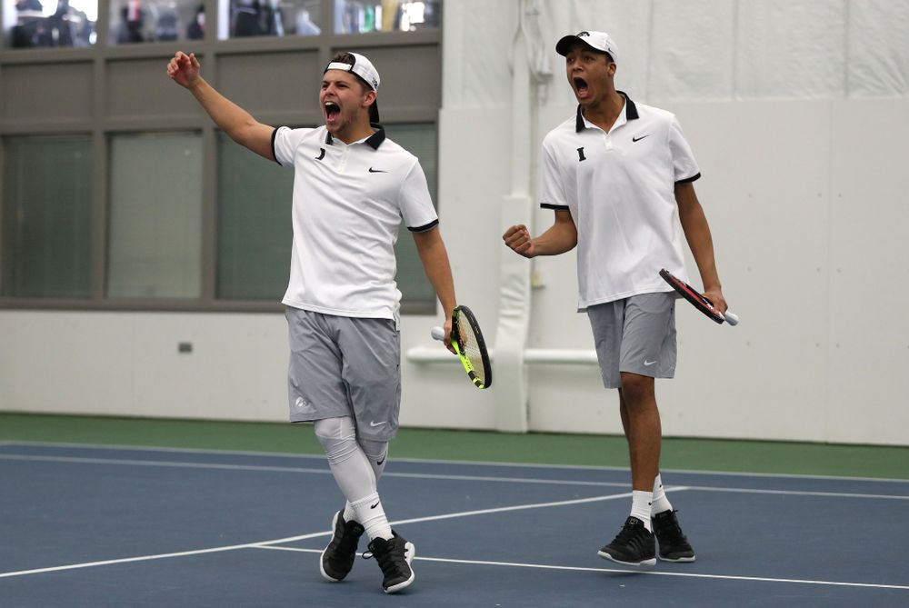 Iowa's Will Davies and Oliver Okonkwo celebrate after winning a doubles match against Western Michigan Saturday, January 19, 2019 at the Hawkeye Tennis and Recreation Complex. (Brian Ray/hawkeyesports.com)