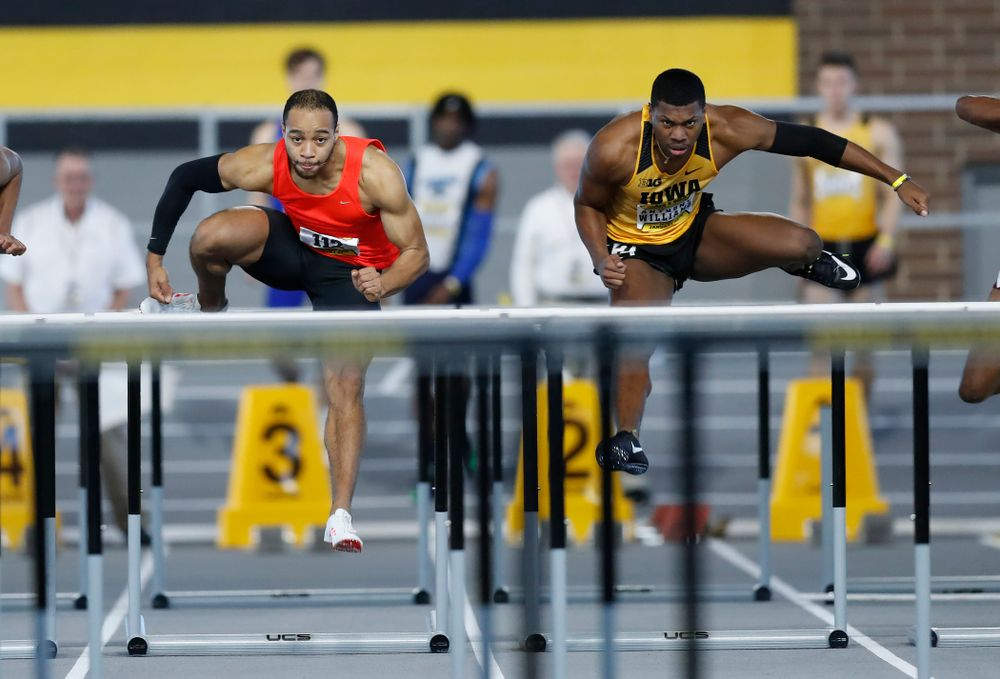 Aaron Mallett and Anthony Williams compete in 60 meter high hurdles