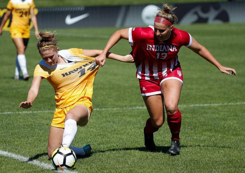 Iowa Hawkeyes defender Leah Moss (14) battles for possession during a game against Indiana at the Iowa Soccer Complex on September 23, 2018. (Tork Mason/hawkeyesports.com)