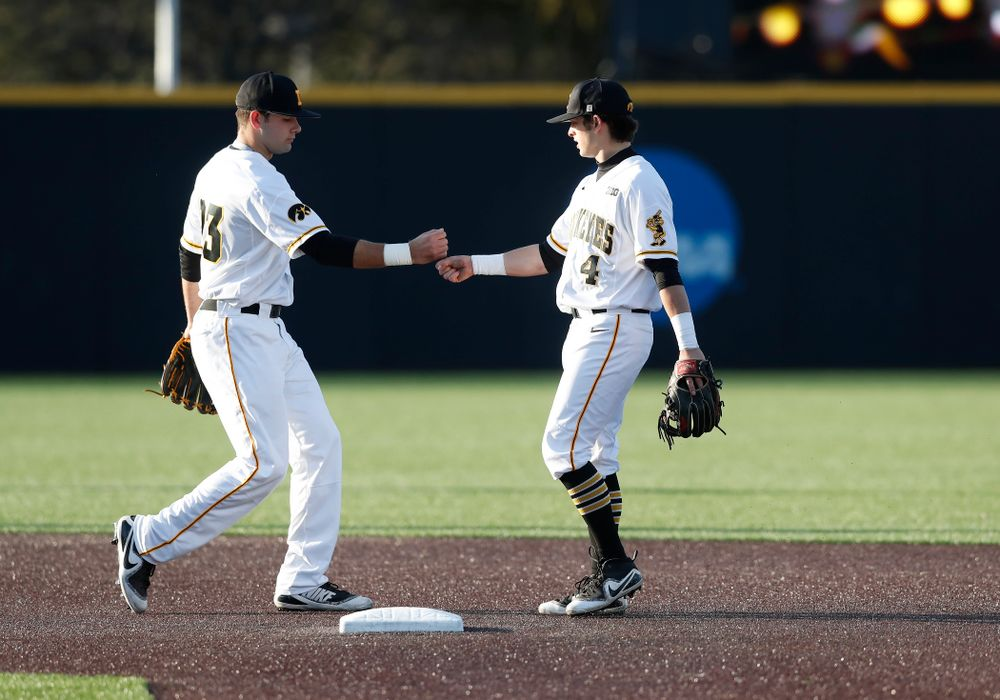 Iowa Hawkeyes infielder Kyle Crowl (23) and infielder Mitchell Boe (4) against Northern Illinois Tuesday, April 17, 2018 at Duane Banks Field. (Brian Ray/hawkeyesports.com)