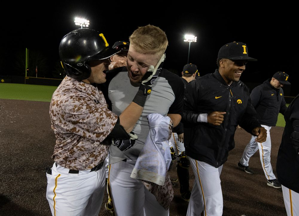 Iowa Hawkeyes Zeb Adreon (5) celebrates with his teammates after driving in the game winning run in the bottom of the 9th against the Nebraska Cornhuskers on Military Appreciation Night Friday, April 19, 2019 at Duane Banks Field. (Brian Ray/hawkeyesports.com)