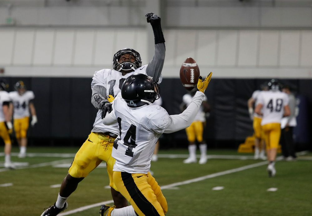 Miles Taylor (19) and Desmond King (14)