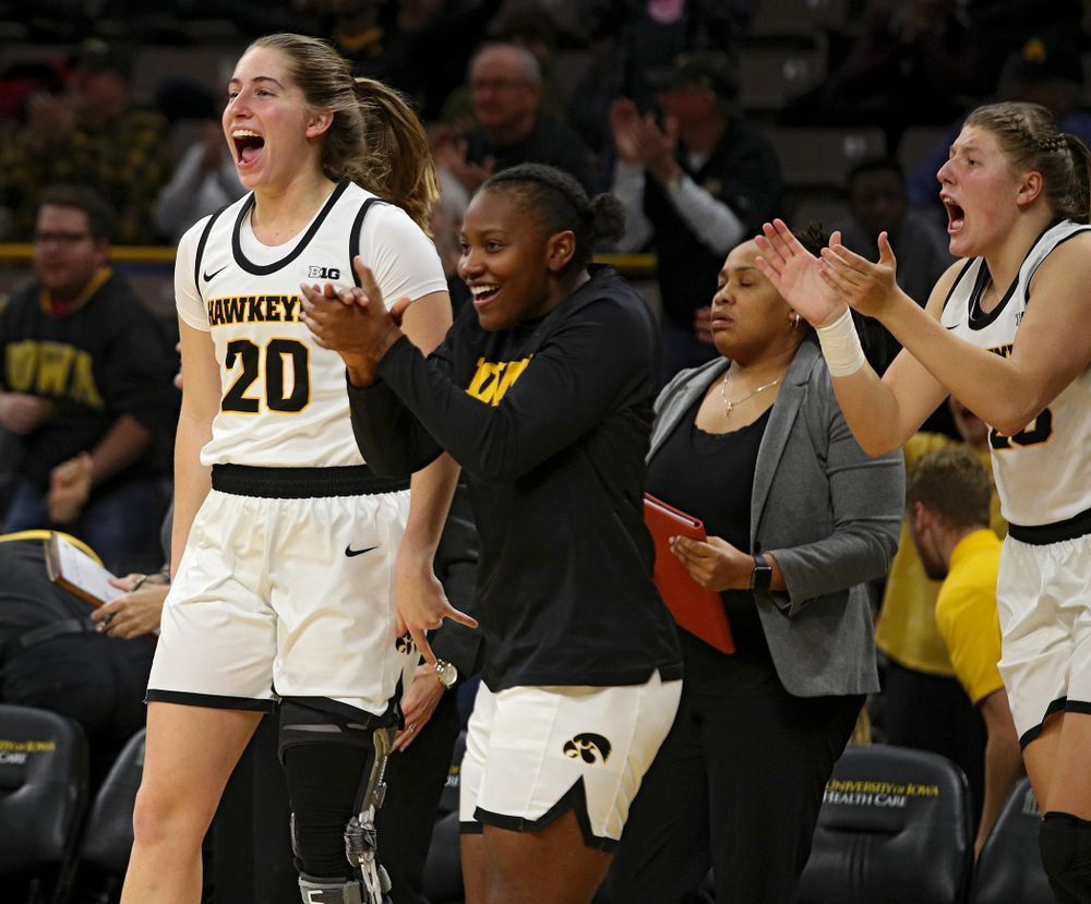 Iowa guard Kate Martin (20), guard Zion Sanders (21), and forward/center Monika Czinano (25) celebrate during the third quarter of their overtime win against Princeton at Carver-Hawkeye Arena in Iowa City on Wednesday, Nov 20, 2019. (Stephen Mally/hawkeyesports.com)