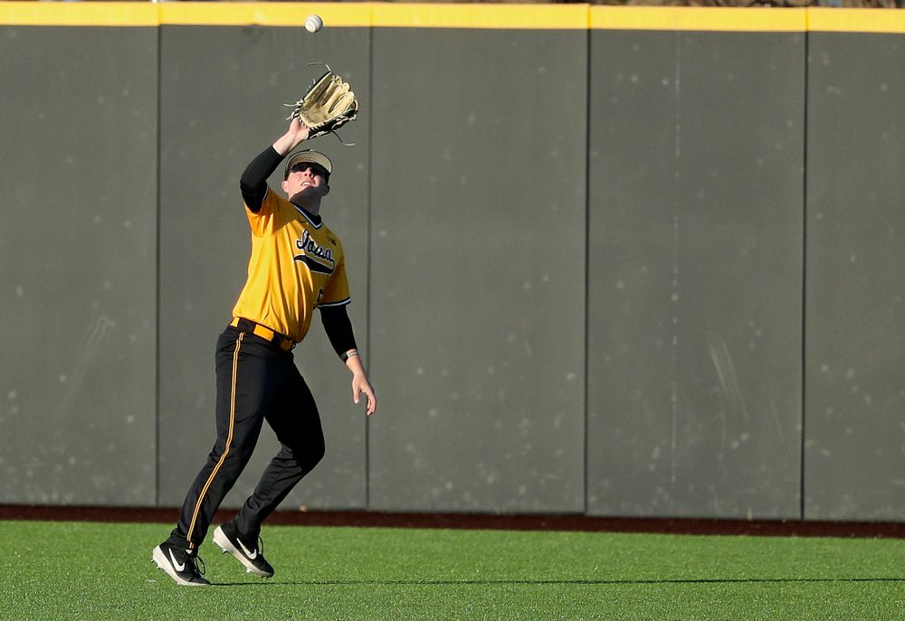 Iowa Hawkeyes right fielder Zeb Adreon (5) pulls in a fly ball for an out during the eighth inning of their game at Duane Banks Field in Iowa City on Tuesday, Apr. 2, 2019. (Stephen Mally/hawkeyesports.com)