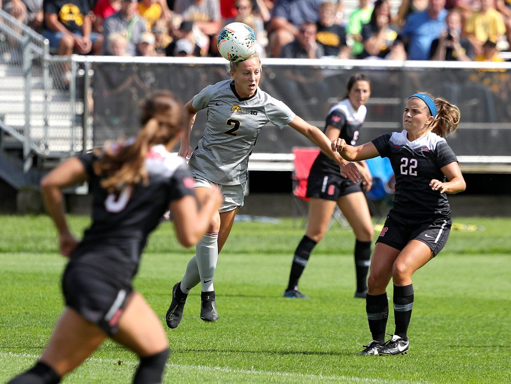 Iowa midfielder Hailey Rydberg (2) wins a header during the first half of their match at the Iowa Soccer Complex in Iowa City on Sunday, Sep 1, 2019. (Stephen Mally/hawkeyesports.com)