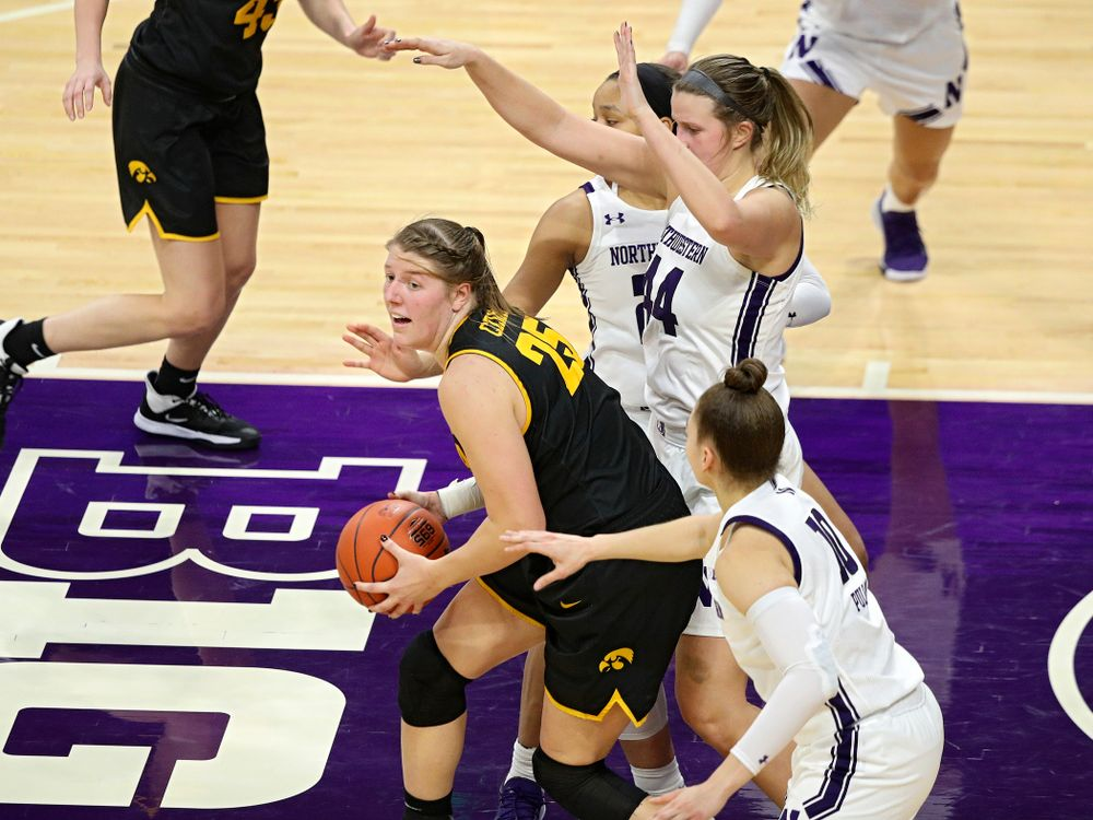 Iowa Hawkeyes forward Monika Czinano (25) looks to pass during the fourth quarter of their game at Welsh-Ryan Arena in Evanston, Ill. on Sunday, January 5, 2020. (Stephen Mally/hawkeyesports.com)