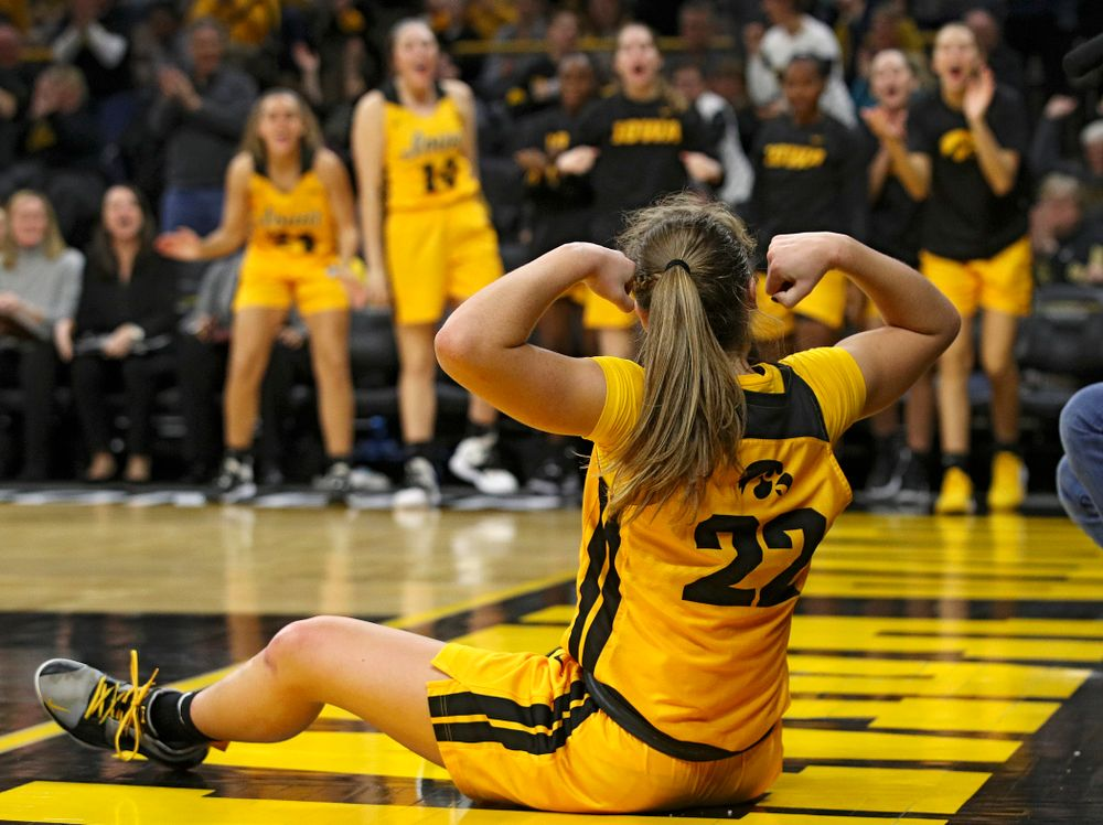 Iowa Hawkeyes guard Kathleen Doyle (22) flexes after making a basket while being fouled during the fourth quarter of their game at Carver-Hawkeye Arena in Iowa City on Thursday, January 23, 2020. (Stephen Mally/hawkeyesports.com)