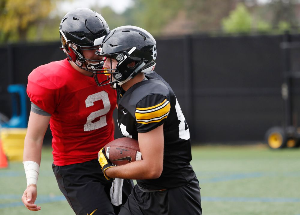 Iowa Hawkeyes wide receiver Nico Ragaini (89) and quarterback Peyton Mansell (2) during practice No. 4 of Fall Camp Monday, August 6, 2018 at the Hansen Football Performance Center. (Brian Ray/hawkeyesports.com)
