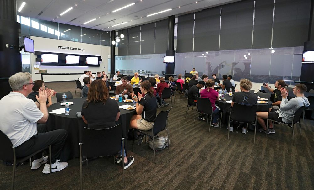 Visitors from the University of Iowa Hospitals and Clinics Adolescent and Young Adult (AYA) Cancer Program speak to the team as they eat at Carver-Hawkeye Arena in Iowa City on Monday, Sep 30, 2019. (Stephen Mally/hawkeyesports.com)