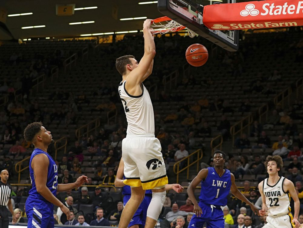Iowa Hawkeyes forward Jack Nunge (2) dunks the ball during the second half of their exhibition game against Lindsey Wilson College at Carver-Hawkeye Arena in Iowa City on Monday, Nov 4, 2019. (Stephen Mally/hawkeyesports.com)