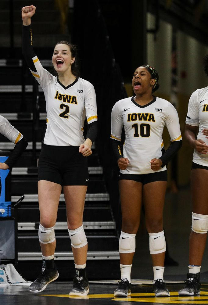 Iowa Hawkeyes setter Courtney Buzzerio (2) and Iowa Hawkeyes outside hitter Griere Hughes (10) react on the bench during a match against Nebraska at Carver-Hawkeye Arena on November 7, 2018. (Tork Mason/hawkeyesports.com)
