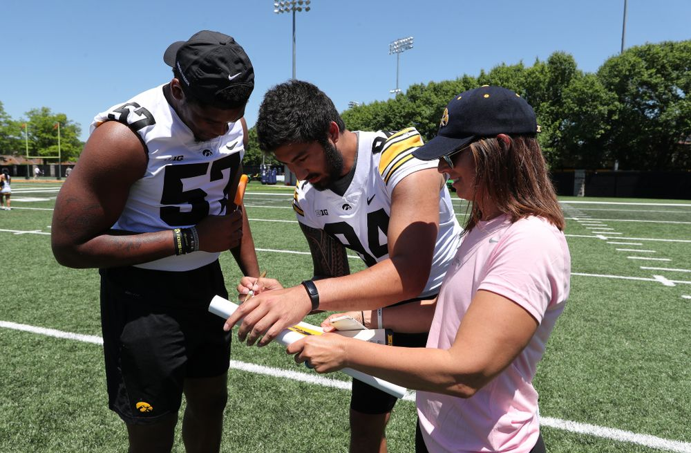 Iowa Hawkeyes defensive end A.J. Epenesa (94) and defensive end Chauncey Golston (57) during the 2019 Iowa Ladies Football Academy Saturday, June 8, 2019 at the Hansen Football Performance Center. (Brian Ray/hawkeyesports.com)