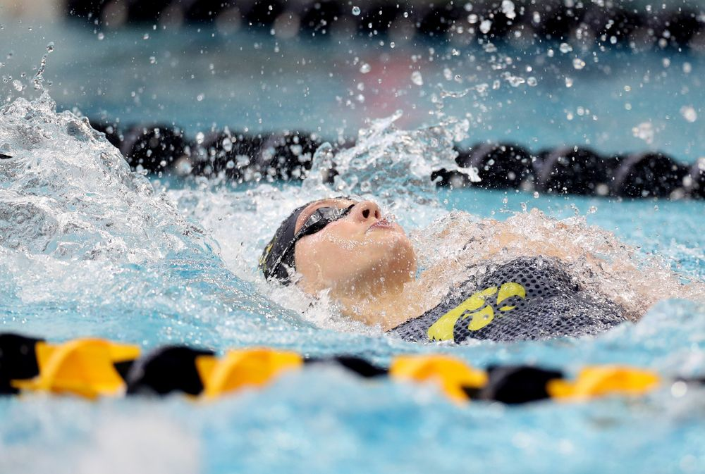 IowaÕs Emily Sansome swims the 100 yard backstroke against the Michigan Wolverines Friday, November 1, 2019 at the Campus Recreation and Wellness Center. (Brian Ray/hawkeyesports.com)