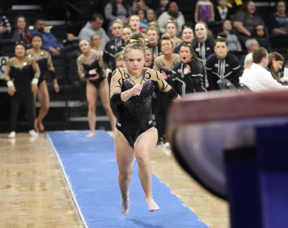 Iowa's Charlotte Sullivan competes on the vault during their meet against Southeast Missouri State Friday, January 11, 2019 at Carver-Hawkeye Arena. (Brian Ray/hawkeyesports.com)
