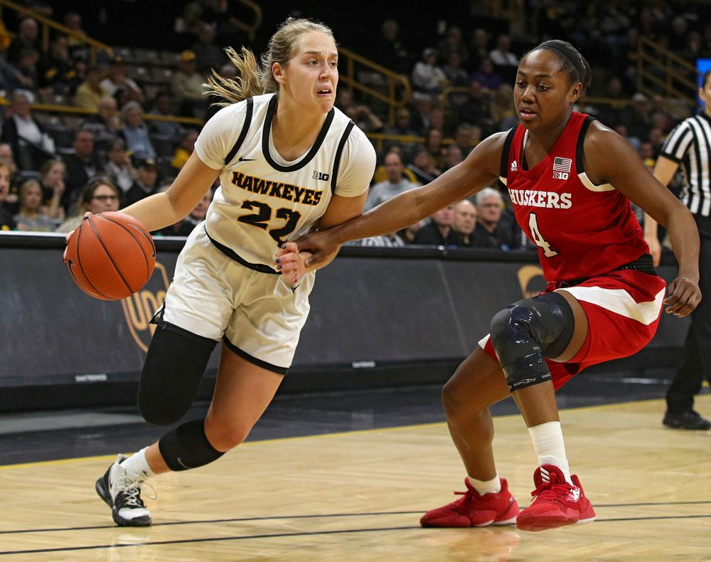 Iowa Hawkeyes guard Kathleen Doyle (22) drives in with the ball during the first quarter of the game at Carver-Hawkeye Arena in Iowa City on Thursday, February 6, 2020. (Stephen Mally/hawkeyesports.com)
