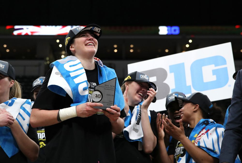 Iowa Hawkeyes forward Megan Gustafson (10) receives the Most Outstanding Player Award following their win against the Maryland Terrapins Sunday, March 10, 2019 at Bankers Life Fieldhouse in Indianapolis, Ind. (Brian Ray/hawkeyesports.com)