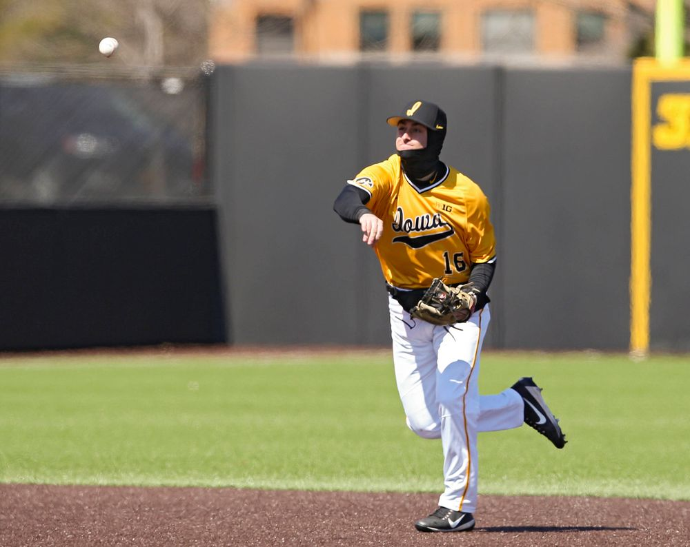 Iowa Hawkeyes shortstop Tanner Wetrich (16) throws to first for an out during the first inning against Illinois at Duane Banks Field in Iowa City on Sunday, Mar. 31, 2019. (Stephen Mally/hawkeyesports.com)
