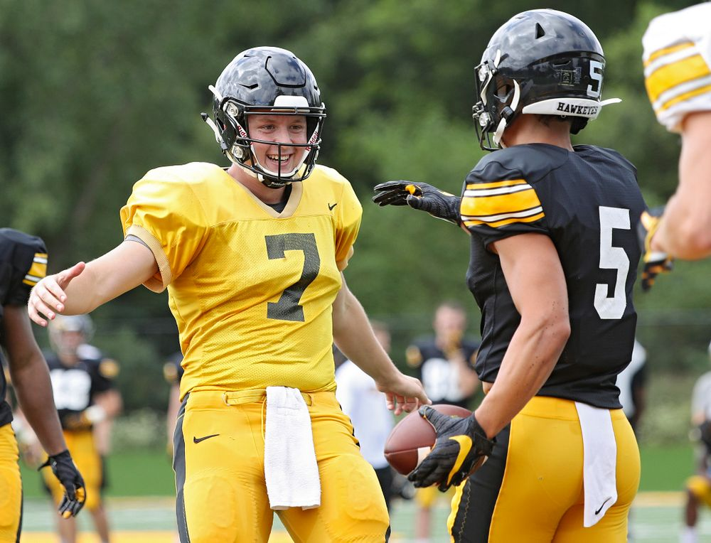 Iowa Hawkeyes quarterback Spencer Petras (7) celebrates with wide receiver Oliver Martin (5) after a touchdown during Fall Camp Practice No. 10 at the Hansen Football Performance Center in Iowa City on Tuesday, Aug 13, 2019. (Stephen Mally/hawkeyesports.com)