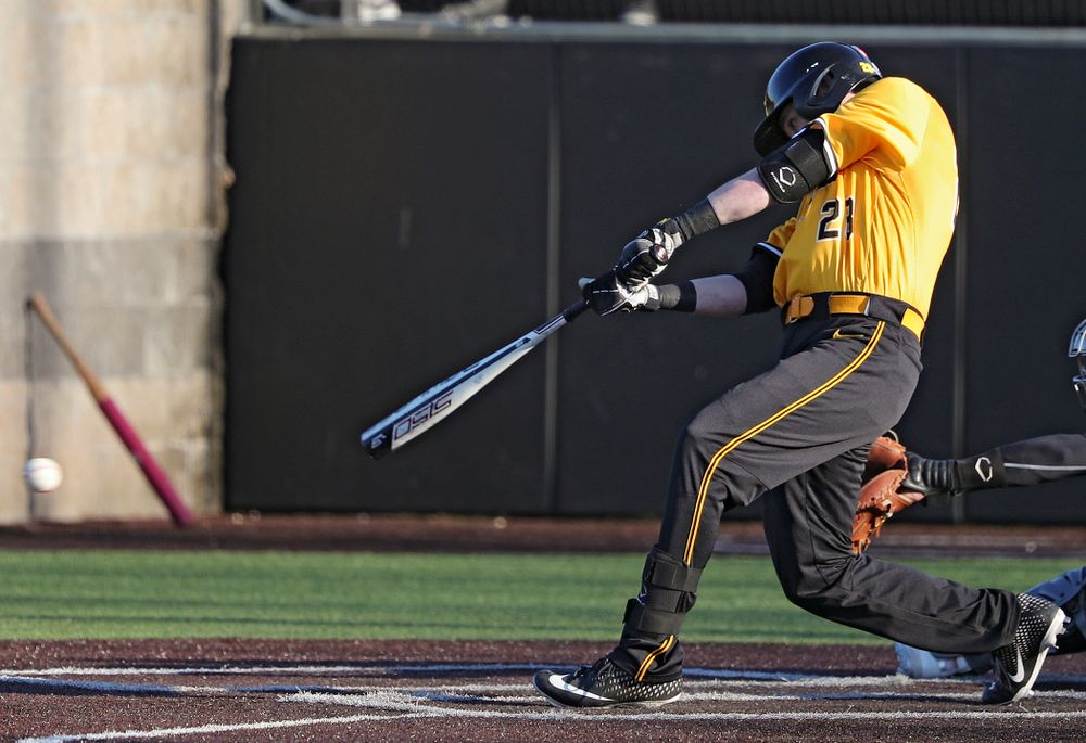 Iowa Hawkeyes left fielder Chris Whelan (28) drives a pitch for a hit during the sixth inning of their game at Duane Banks Field in Iowa City on Tuesday, Apr. 2, 2019. (Stephen Mally/hawkeyesports.com)