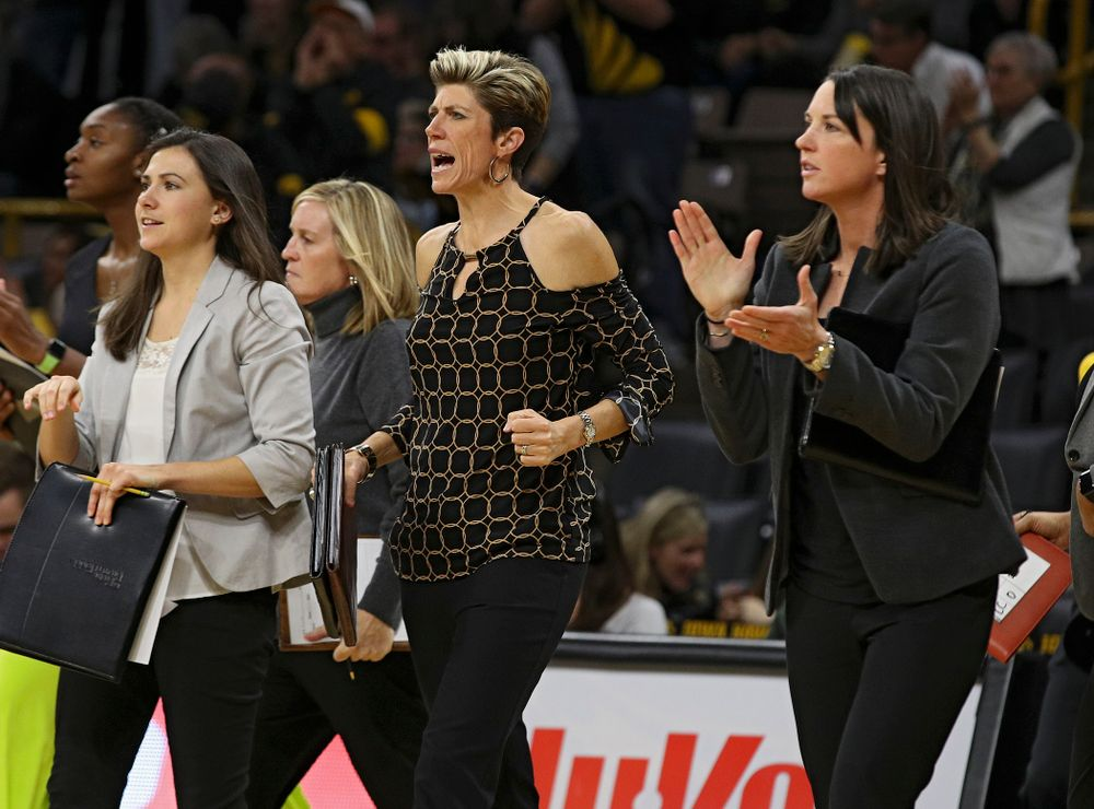 Iowa associate head coach Jan Jensen pumps her fist and assistant coach Abby Stamp claps during the third quarter of their overtime win against Princeton at Carver-Hawkeye Arena in Iowa City on Wednesday, Nov 20, 2019. (Stephen Mally/hawkeyesports.com)