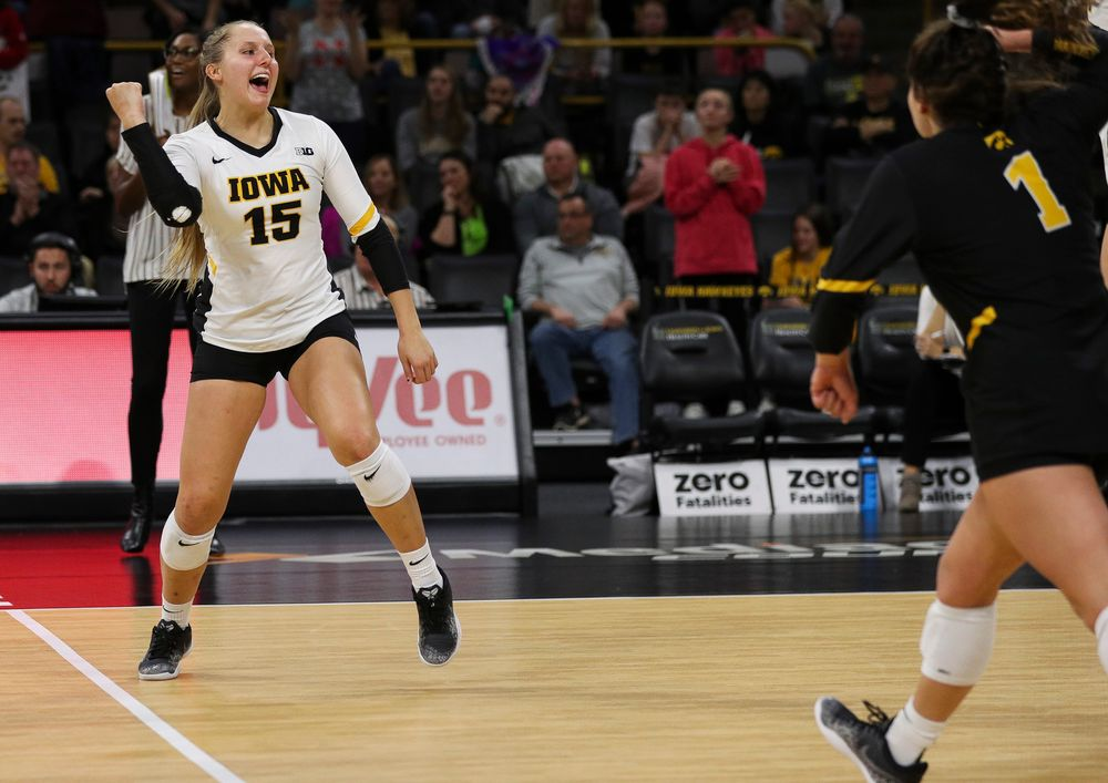Iowa Hawkeyes defensive specialist Maddie Slagle (15) celebrates after winning a point during a match against Nebraska at Carver-Hawkeye Arena on November 7, 2018. (Tork Mason/hawkeyesports.com)