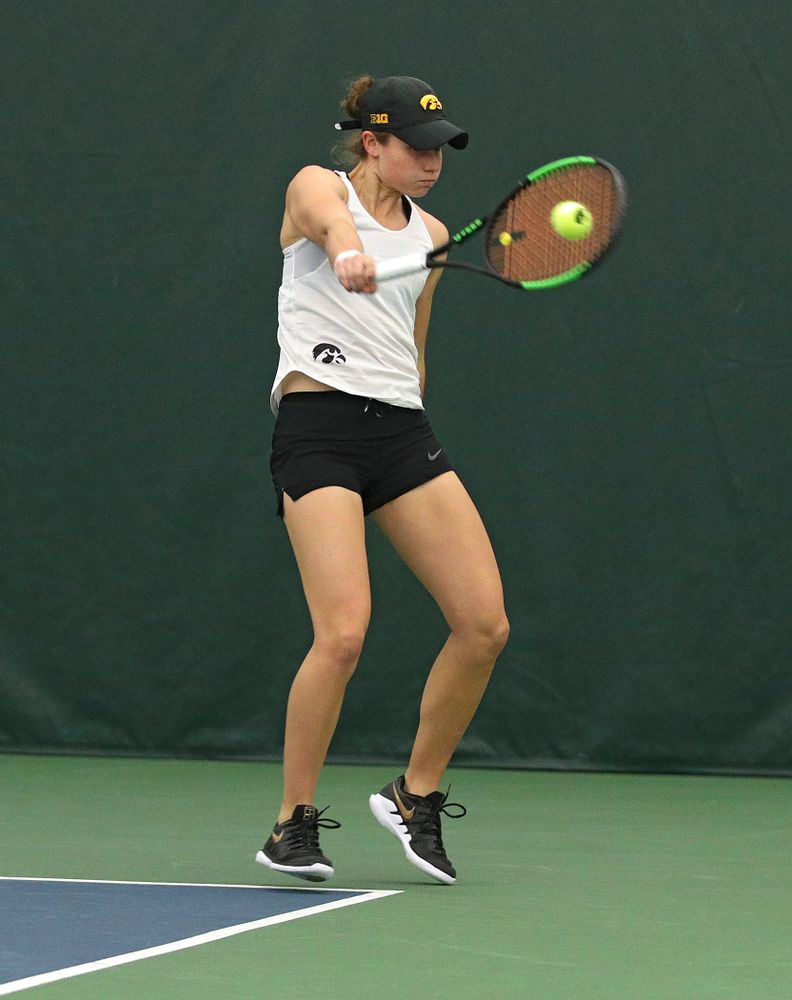 Iowa's Elise Van Heuvelen returns a shot during her doubles match at the Hawkeye Tennis and Recreation Complex in Iowa City on Sunday, February 23, 2020. (Stephen Mally/hawkeyesports.com)