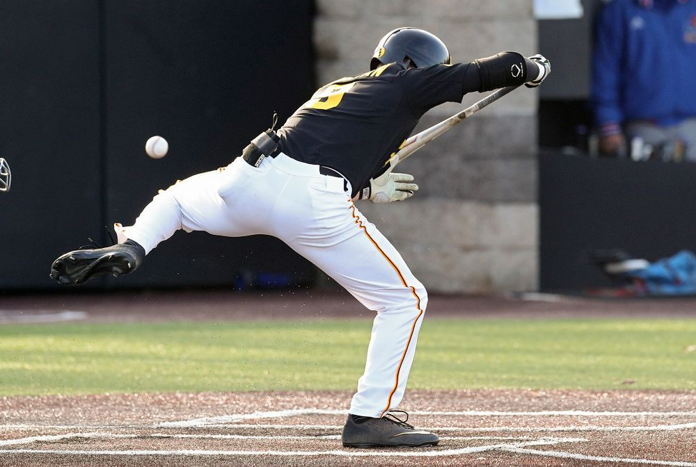 Iowa outfielder Ben Norman (9) is hit by a pitch during the fourth inning of their college baseball game at Duane Banks Field in Iowa City on Tuesday, March 10, 2020. (Stephen Mally/hawkeyesports.com)