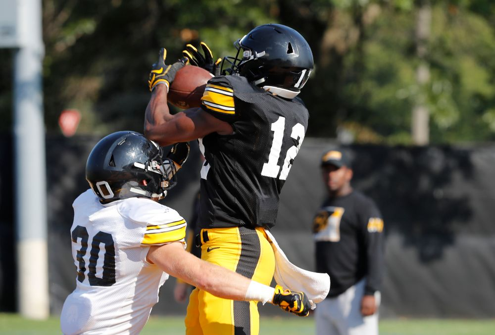 Iowa Hawkeyes wide receiver Brandon Smith (12) during camp practice No. 17 Wednesday, August 22, 2018 at the Kenyon Football Practice Facility. (Brian Ray/hawkeyesports.com)