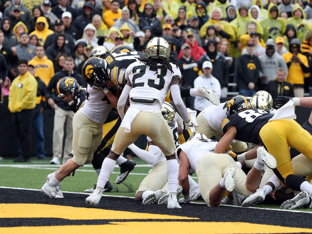 Iowa Hawkeyes running back Tyler Goodson (15) scores his first career touchdown against the Purdue Boilermakers Saturday, October 19, 2019 at Kinnick Stadium. (Brian Ray/hawkeyesports.com)