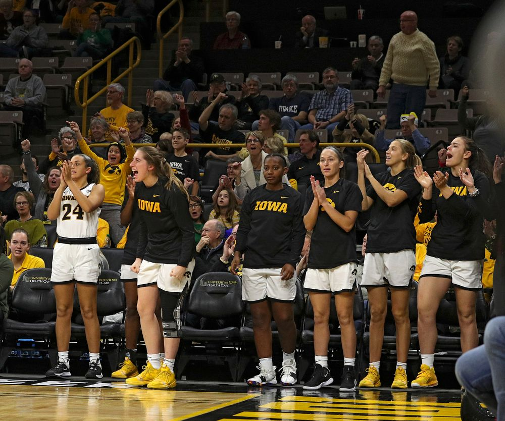 The Iowa bench cheers during the third quarter of their game at Carver-Hawkeye Arena in Iowa City on Saturday, December 21, 2019. (Stephen Mally/hawkeyesports.com)