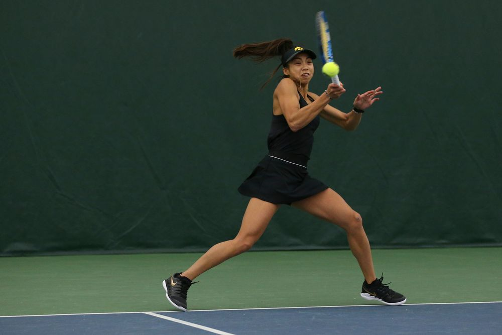 Iowa's Michelle Bacalla returns a hit during the Iowa women's tennis meet vs UNI  on Saturday, February 29, 2020 at the Hawkeye Tennis and Recreation Complex. (Lily Smith/hawkeyesports.com)