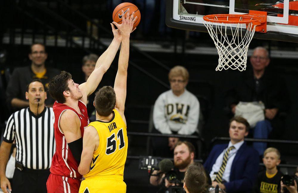 Iowa Hawkeyes forward Nicholas Baer (51) blocks a shot by Wisconsin's Ethan Happ on November 30, 2018 at Carver-Hawkeye Arena. (Tork Mason/hawkeyesports.com)