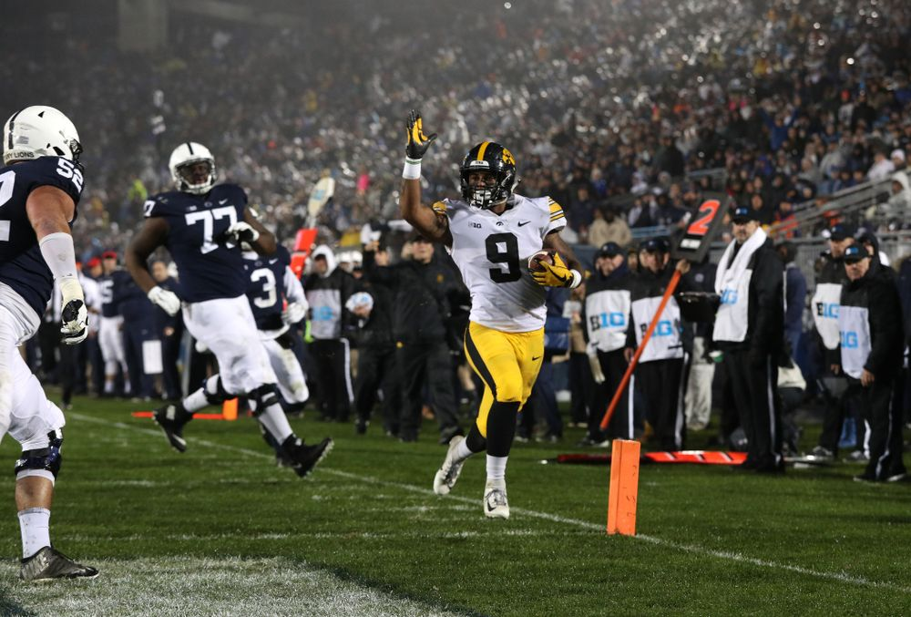 Iowa Hawkeyes defensive back Geno Stone (9) takes an interception back for a touchdown against the Penn State Nittany Lions Saturday, October 27, 2018 at Beaver Stadium in University Park, Pa. (Brian Ray/hawkeyesports.com)