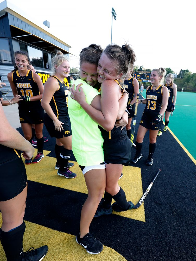 Iowa Hawkeyes Maddy Murphy (26) hugs Grace McGuire (62) following their game against the Penn Quakers Friday, September 14, 2018 at Grant Field. (Brian Ray/hawkeyesports.com)