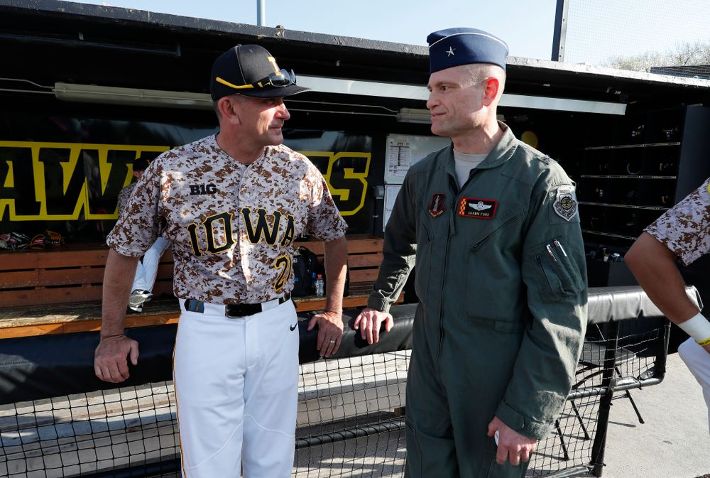 Iowa Hawkeyes head coach Rick Heller talks with brigadier general Shawn Ford before the Hawkeyes game against Oklahoma State Friday, May 4, 2018 at Duane Banks Field. (Brian Ray/hawkeyesports.com)