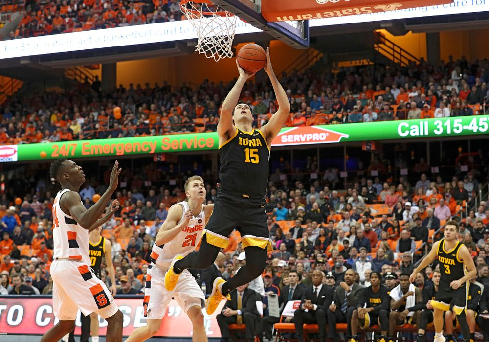 Iowa Hawkeyes forward Ryan Kriener (15) makes a basket during the second half of their ACC/Big Ten Challenge game at the Carrier Dome in Syracuse, N.Y. on Tuesday, Dec 3, 2019. (Stephen Mally/hawkeyesports.com)