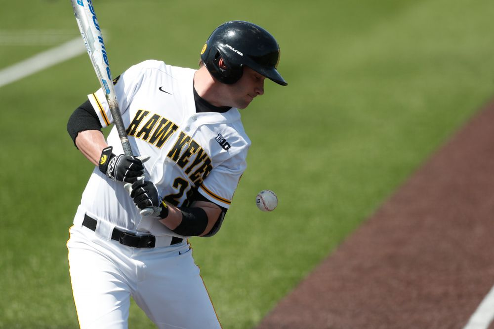 Iowa Hawkeyes infielder Chris Whelan (28) is hit by a pitch against the Oklahoma State Cowboys Saturday, May 5, 2018 at Duane Banks Field. (Brian Ray/hawkeyesports.com)